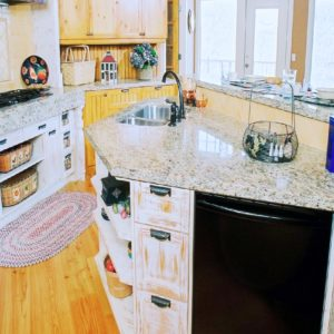 white faux finished cabinets