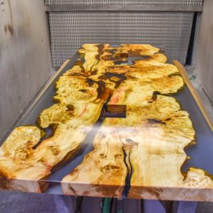 live edge slab conference table with multiple epoxy spaces