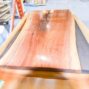 large rough slab with gloss finish drying in our custom wood finishing shop
