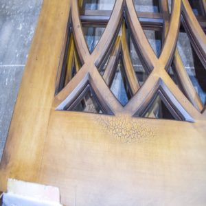 faux aged cracked finish on entrance door with medium brown stained wood finished by Jeco Calgary custom wood finishing