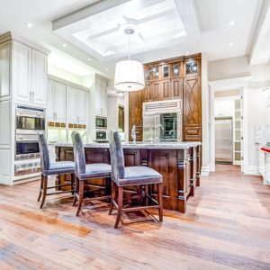 rich dark wood stained kitchen cabinets mixed with painted white cabinets in open concept kitchen