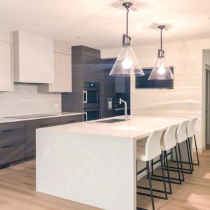 pigmented white and brown cabinets in modern kitchen finished by Jeco custom wood finishing