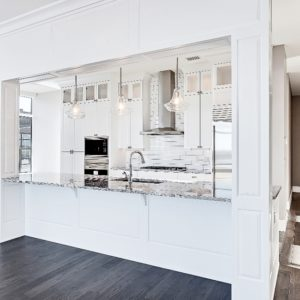 modern white kitchen with painted cabinets finished by Jeco Calgary custom wood finishing