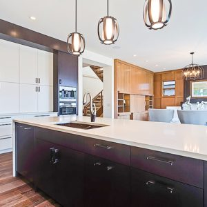 contrasting dark and light stained cabinets in joined kitchen and dining room
