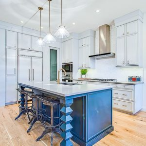 unique white painted cabinets with intense blue pigmented island by Jeco Calgary custom wood finishing
