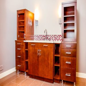 red-brown stained bathroom cabinets