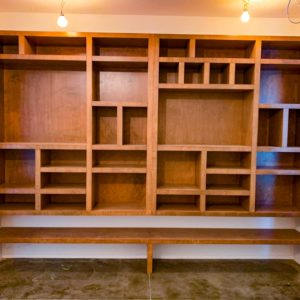 closet and storage spaces with warm brown stain finish