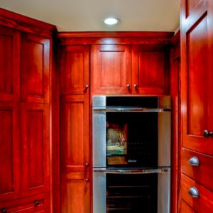 kitchen with deep red gloss cabinets