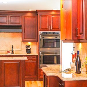 medium brown stained cabinets in large modern kitchen