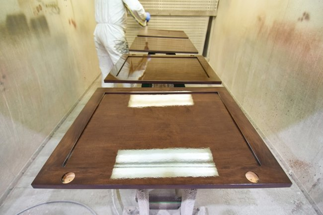 ultra high gloss finish being applied in our clean painting booth