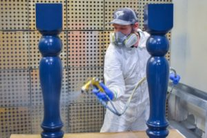 spraying millwork with a rich pigmented blue finish